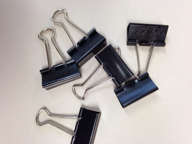 Binder clips to use when sorting posters